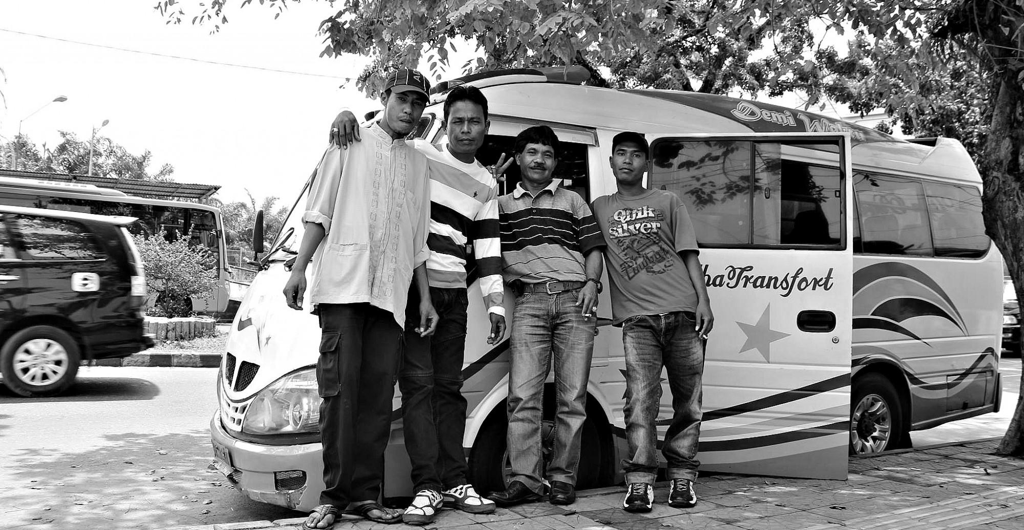 Ankords (mini van taxi) drivers in Padang. Photo by Ovidi Balaj