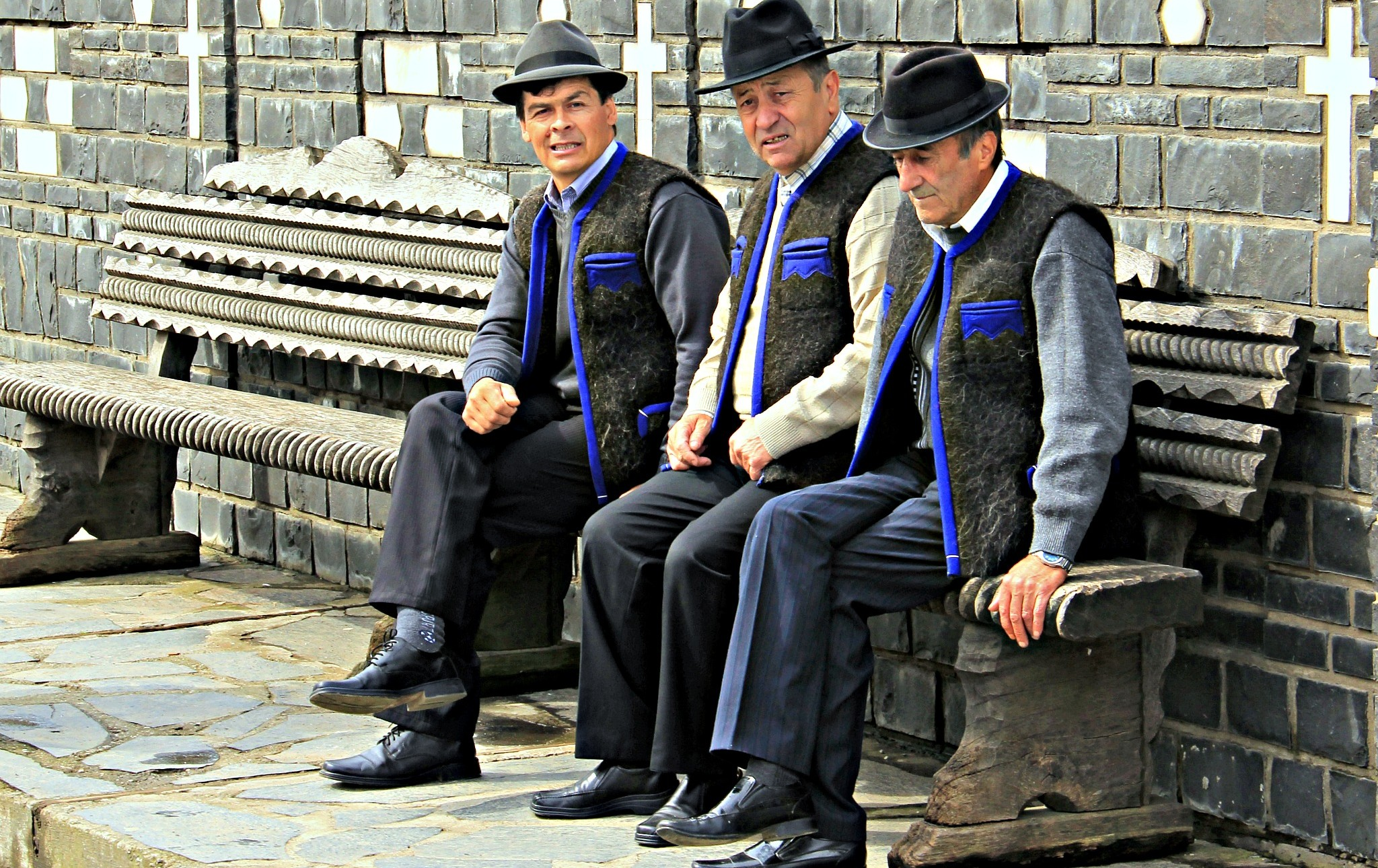 Men relaxing at the entrance in the cemetery. Photo by Ovidiu Balaj