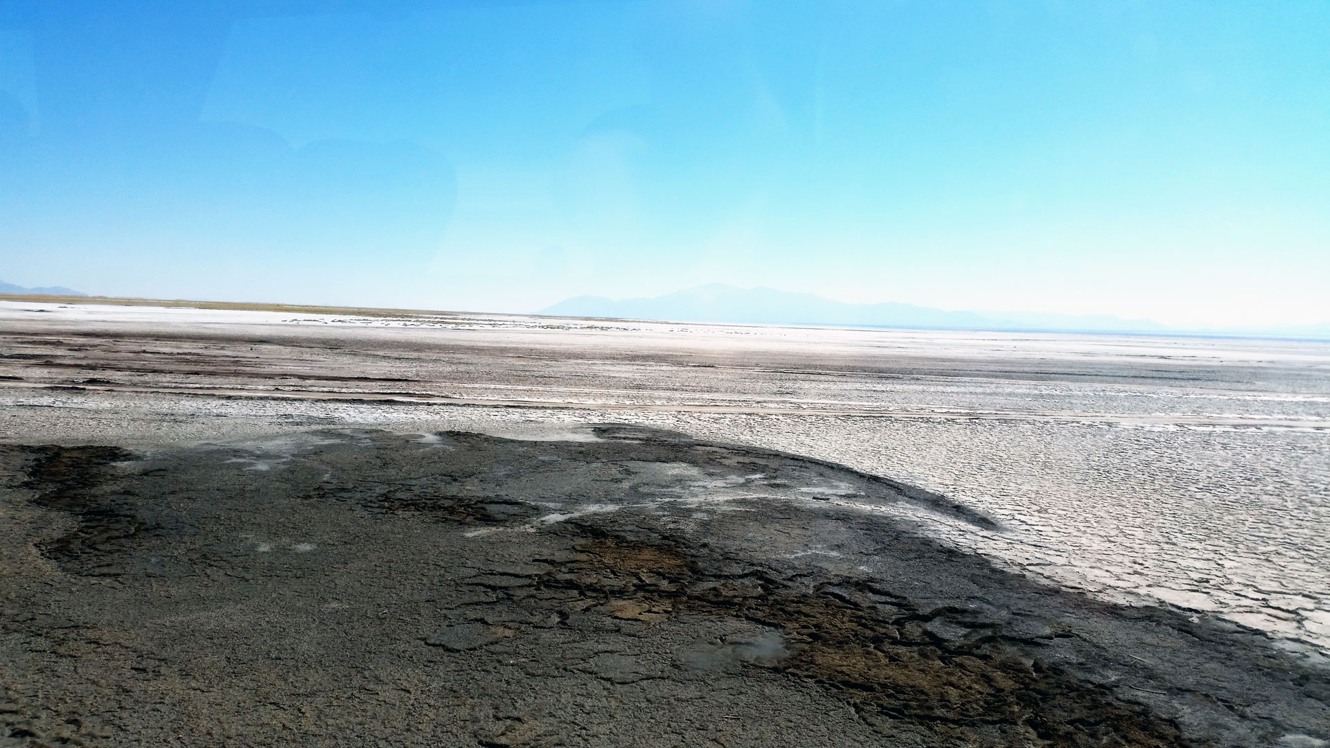 This huge dried up lake  is a crust of salt up to half-a-meter thick.  Sometimes the contrast between bright blue sky and the cracked and crusty white salt is almost blinding. Photo by Ovidiu Balaj